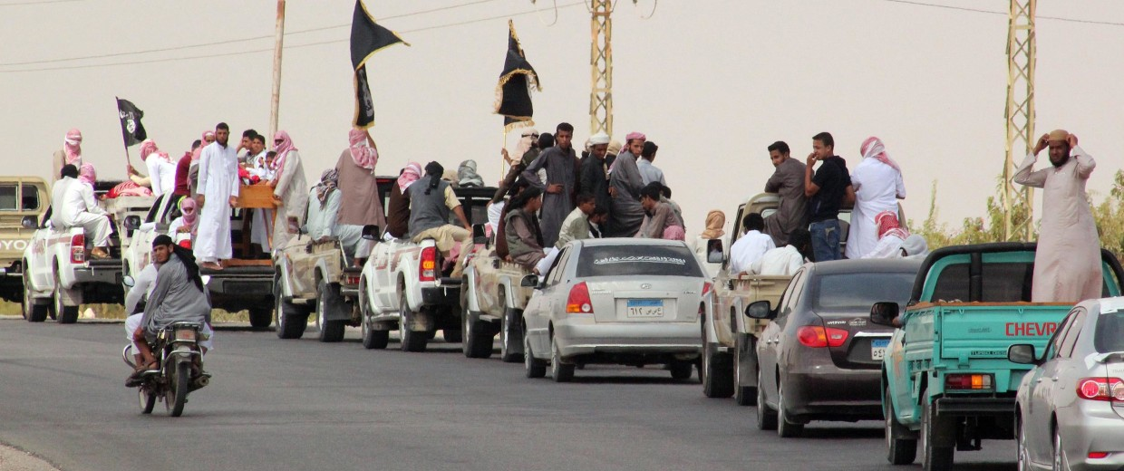 A funeral convoy carrying the bodies of four Egyptian militants