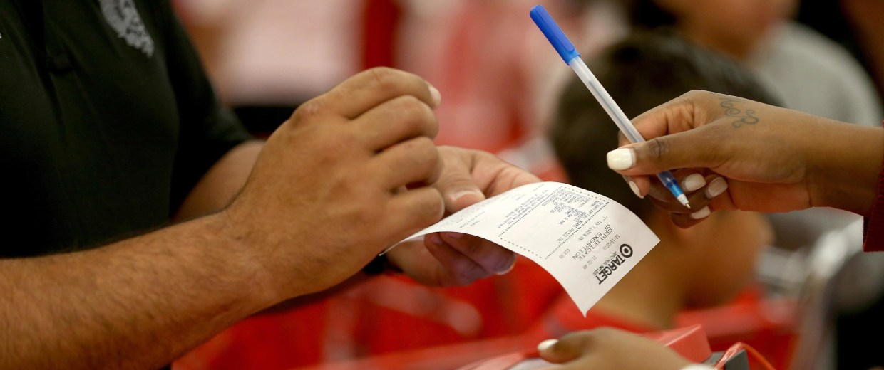Image: A customer prepares to sign a credit card slip at a Target store