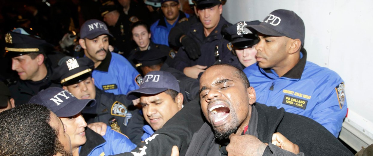 Image: Protesters are removed from blocking the Lincoln tunnel by the New York Police in New York