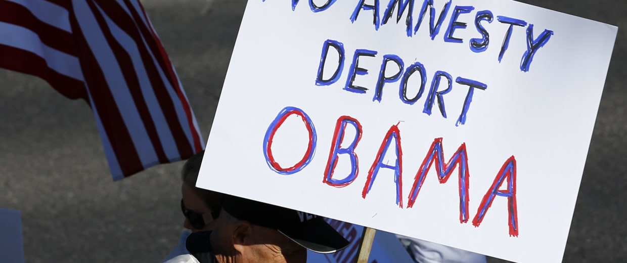 Image: Anti-Obama protesters gather across the street from Del Sol High School where U.S. President Obama is scheduled to deliver remarks on his use of executive authority to relax U.S. immigration policy in Las Vegas, Nevada