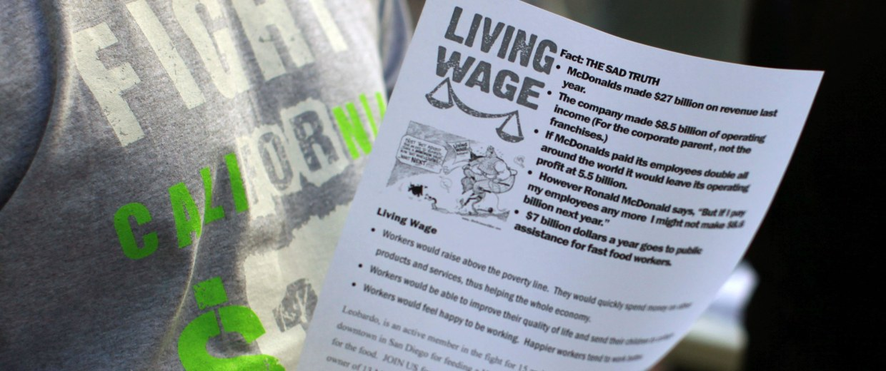 Image: Protesters pass out information sheets outside a Wendy's fast food outlet in support of a nationwide strike and protest at fast food restaurants to raise the minimum hourly wage to $15 in San Diego
