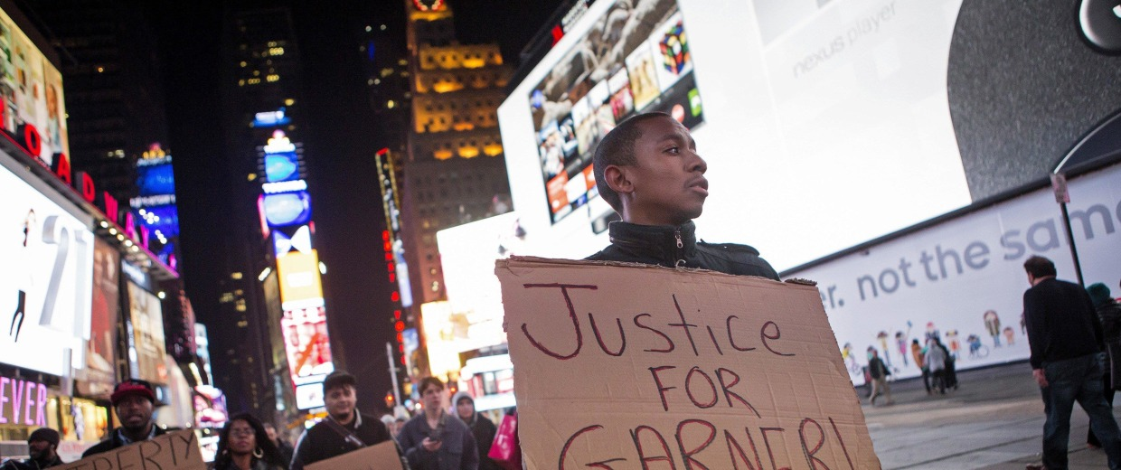 Image: People protest in midtown Manhattan in New York