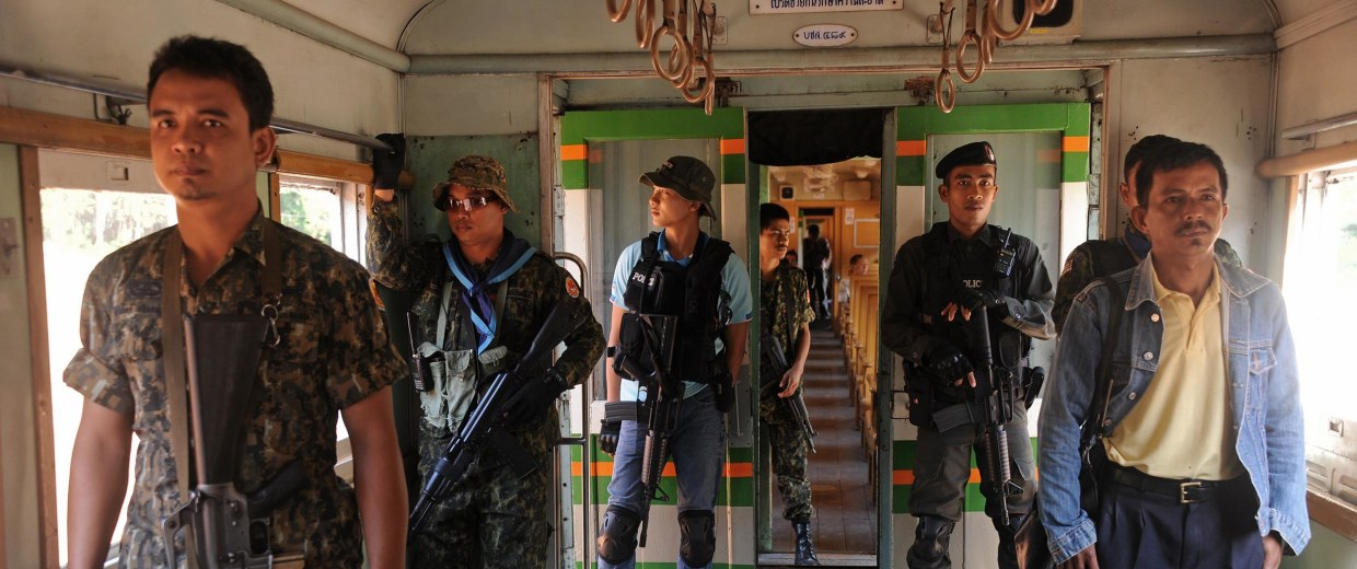 Thai guards on a train