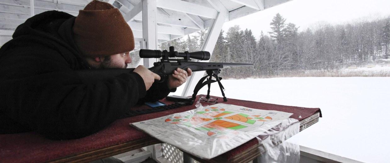 Image: Nick Giampetruzzi calibrates the scope on a Remington Model 700 SPS Varmint rifle