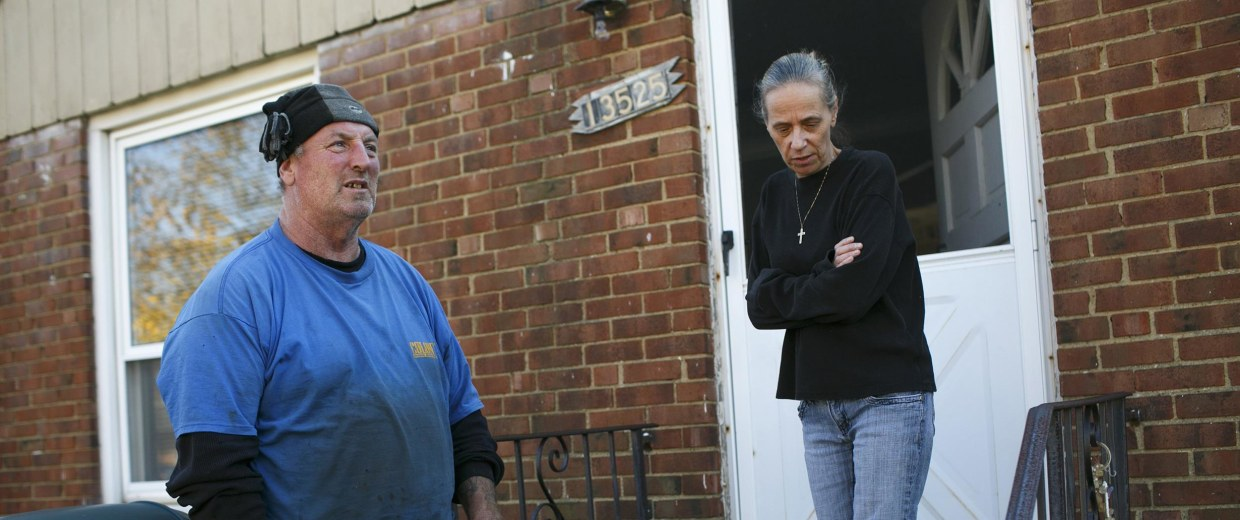 Image: Tony and Donna Cox stand outside of their home in Cleveland, OH