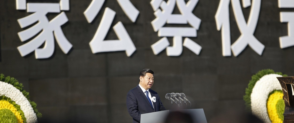 Image: Chinese President Xi Jinping delivers a speech during a memorial ceremony at the Nanjing Massacre Museum in Nanjing