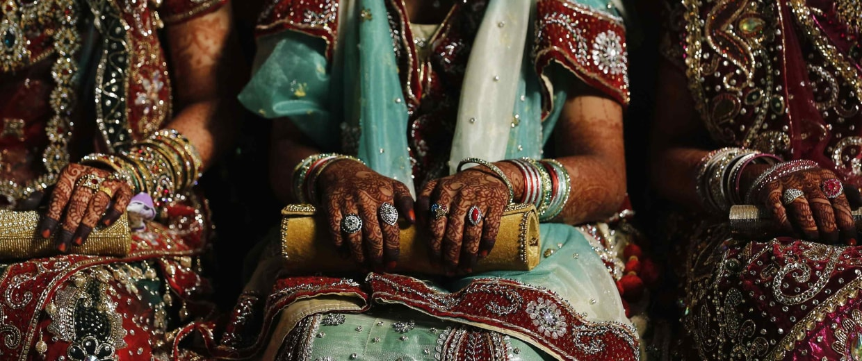 Image: Muslim brides wait for start of mass marriage ceremony in Mumbai