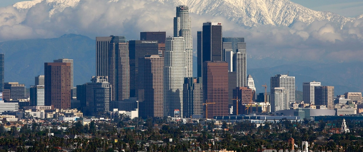 Image: Fresh snow blankets the mountains behind downtown Los Angeles in January 2008