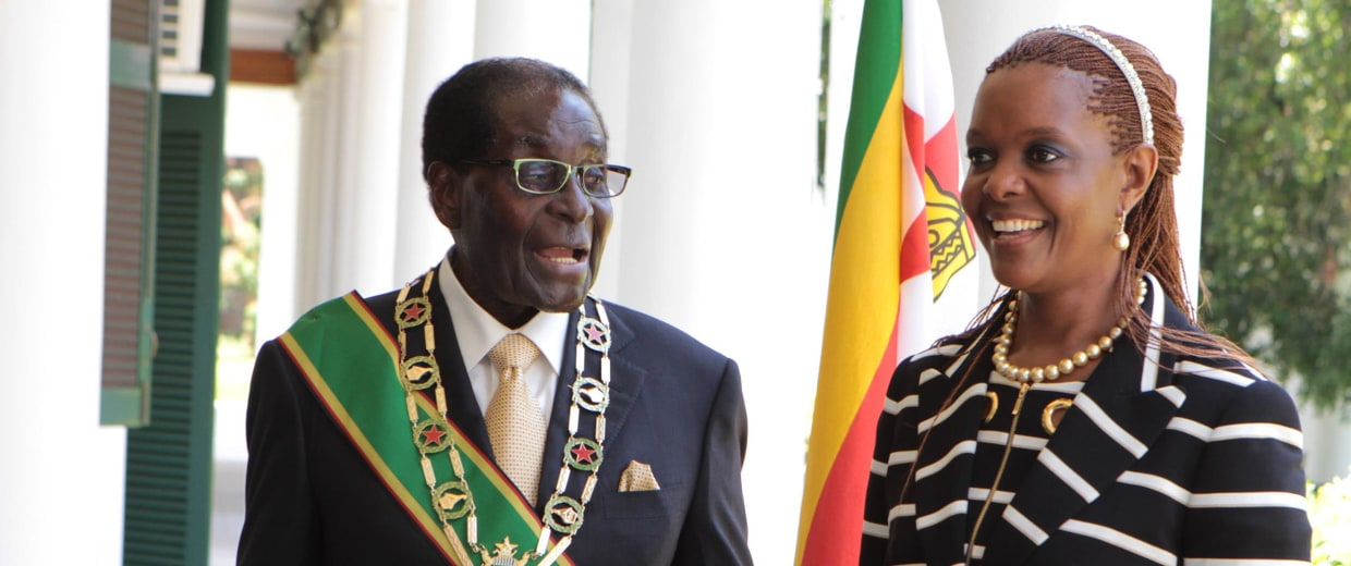 Zimbabwe President Robert Mugabe stands with his wife Grace