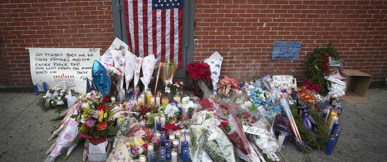 Image: The makeshift memorial is pictured where two police officers were shot in the head in the Brooklyn borough of New York