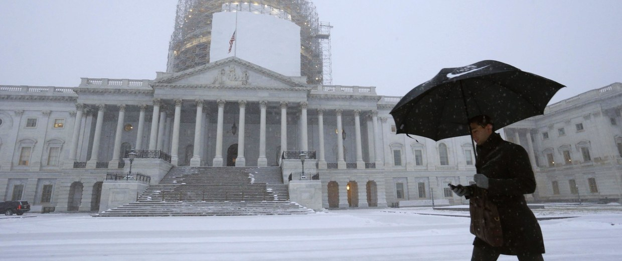 Image: A light snow blankets the east front of the U.S. Capitol in Washington
