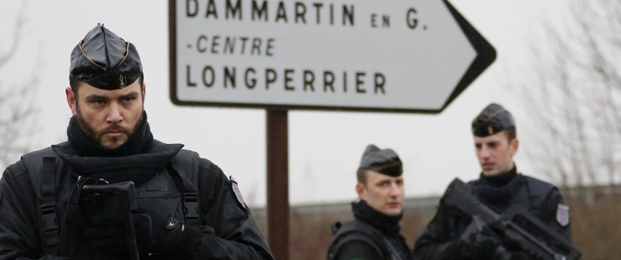 Image: French gendarmes secure the roundabout near the scene of a hostage taking at an industrial zone in Dammartin-en-Goele, northeast of Paris
