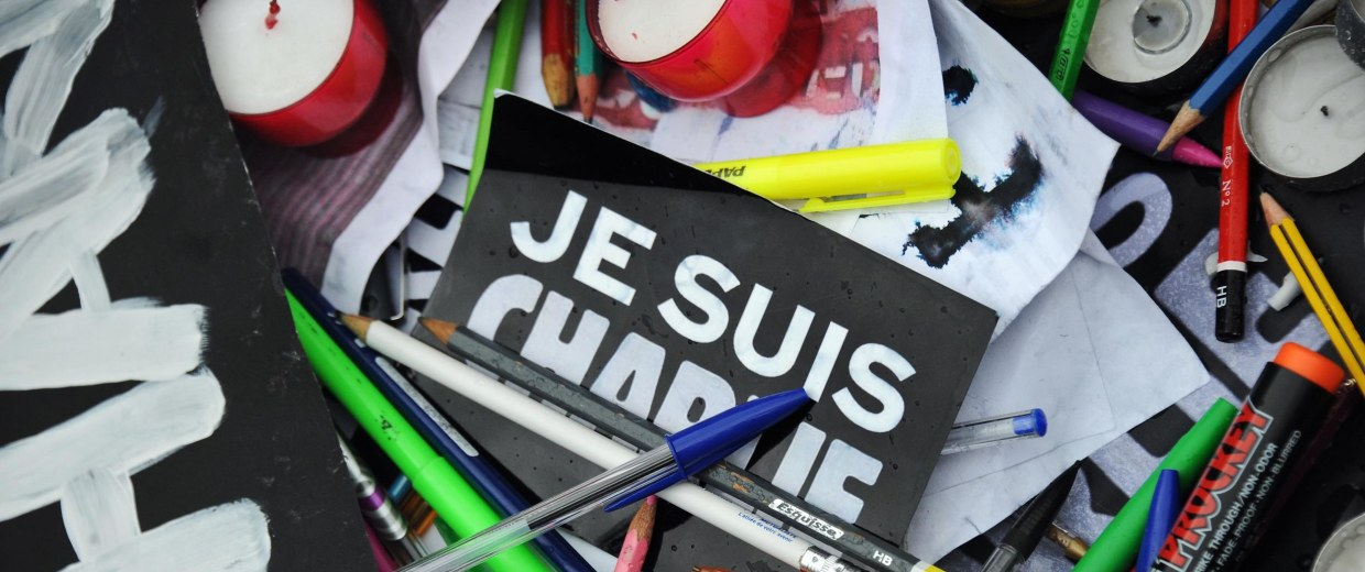 Image: Pens and signs reading 'I am Charlie''