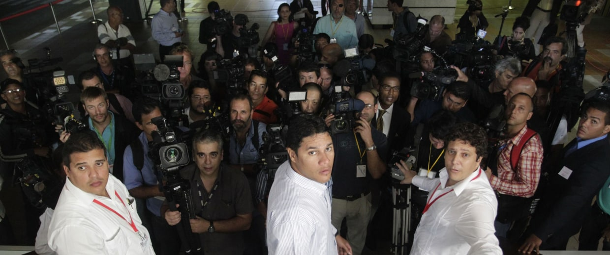 Image: Journalists wait to enter the room where negotiations to restore diplomatic ties between the U.S. and Cuba are taking place in Havana