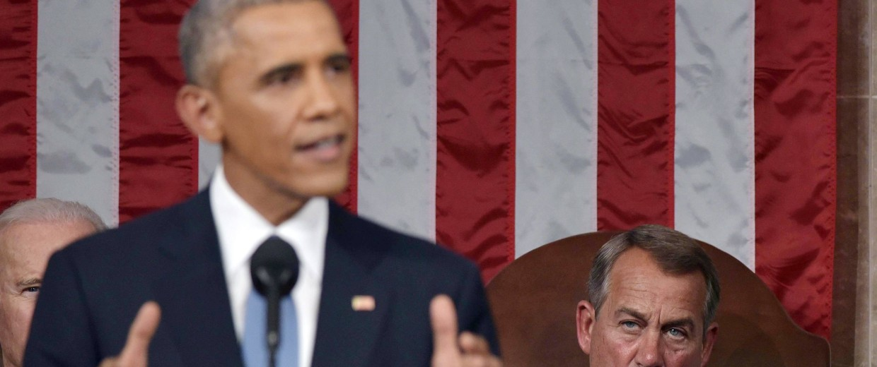 Image: U.S. House Speaker Boehner listens to President Obama deliver his State of the Union address to a joint session of Congress on Capitol Hill in Washington