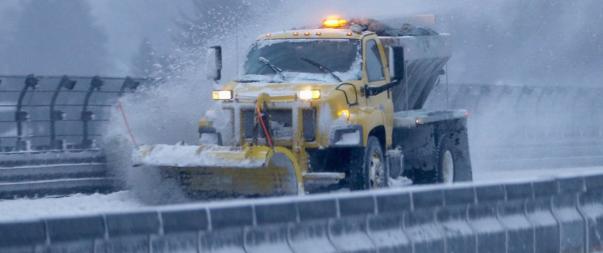 Image: A snow plow clears the road of snow along the New York State Thruway Interstate 87 in Tarrytown