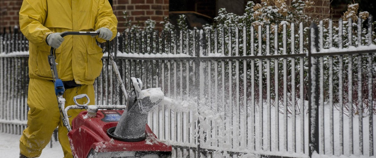 Image: A worker clears snow at New York's Central Park Zoo following a morning snow fall