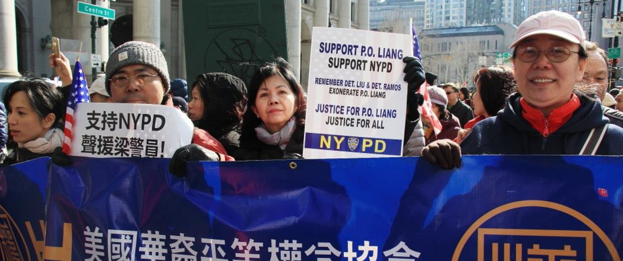 Supporters rally for NYPD Officer Peter Liang, indicted for the Brooklyn shooting of Akai Gurley, an unarmed man.