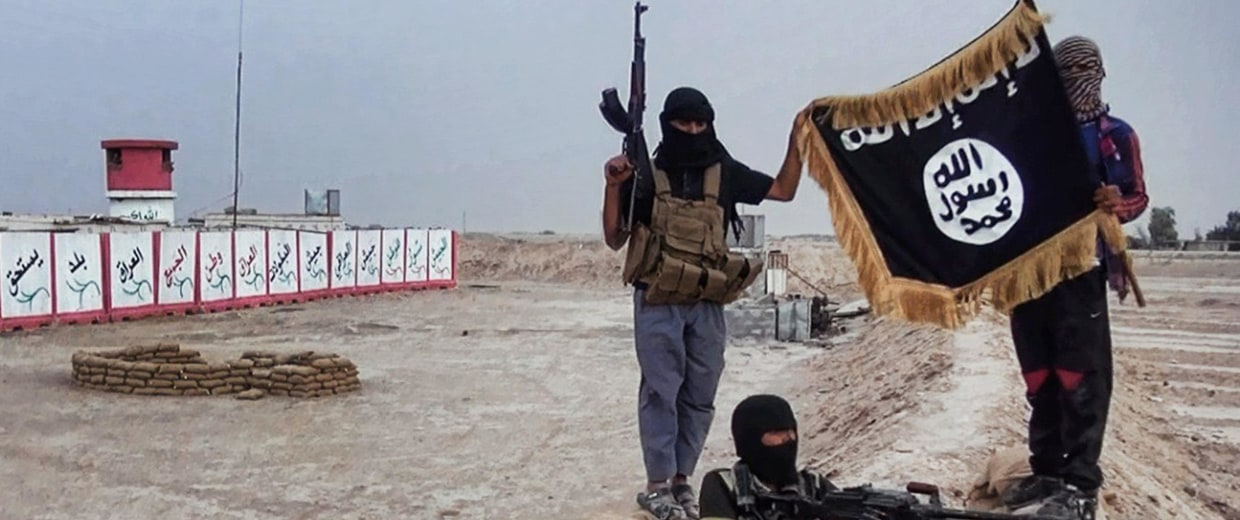Image: Militants of the Islamic State of Iraq and Syria (ISIS) pose with their trademark flag