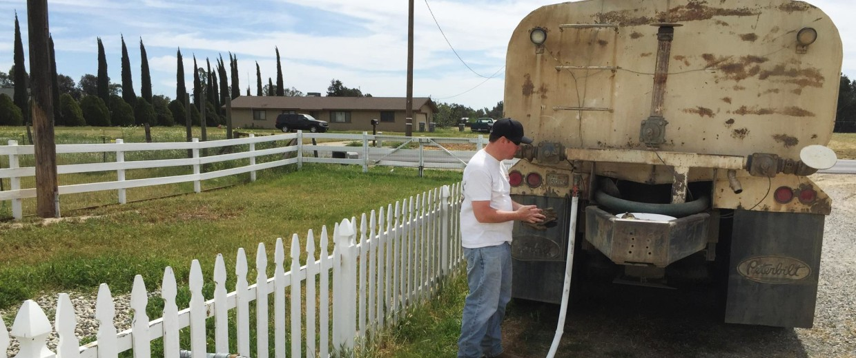 Image: Water truck delivery at home just outside Clovis, California.