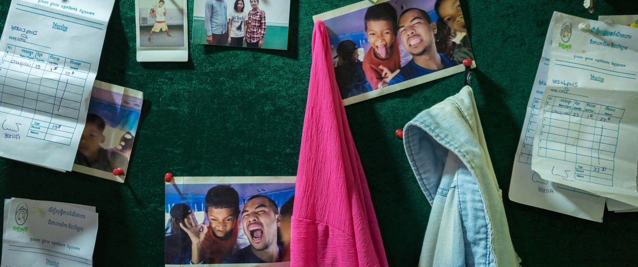 Image:  Photos of Ron Ung are seen on a board  in one of the school supported by YMCA located in a poor neighborhood of Phnom Penh.
