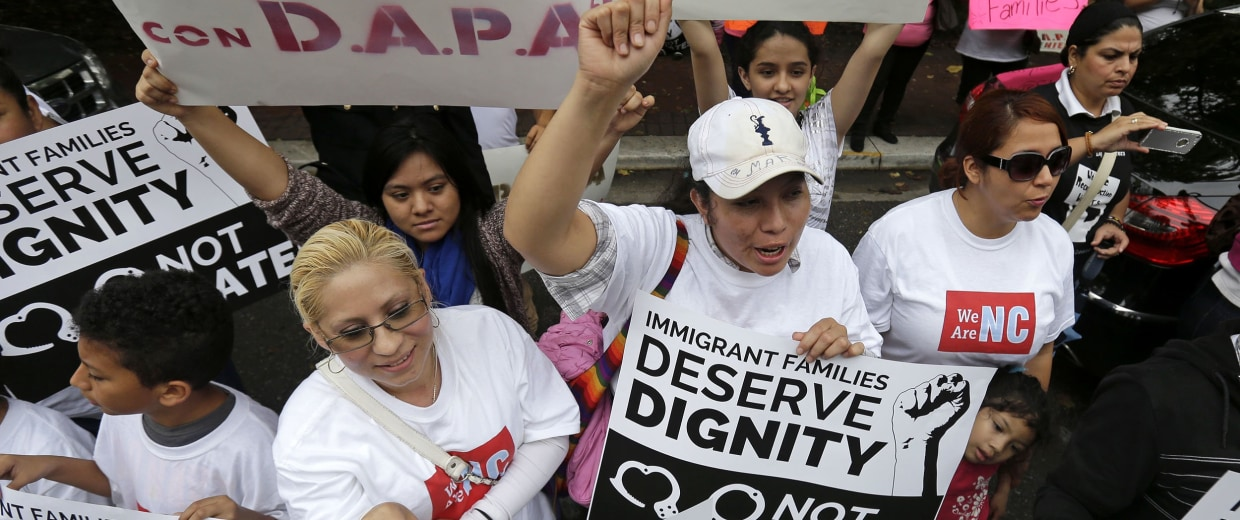 Image: Demonstrators for immigration reform outside US Fifth Circuit Court of Appeals Building