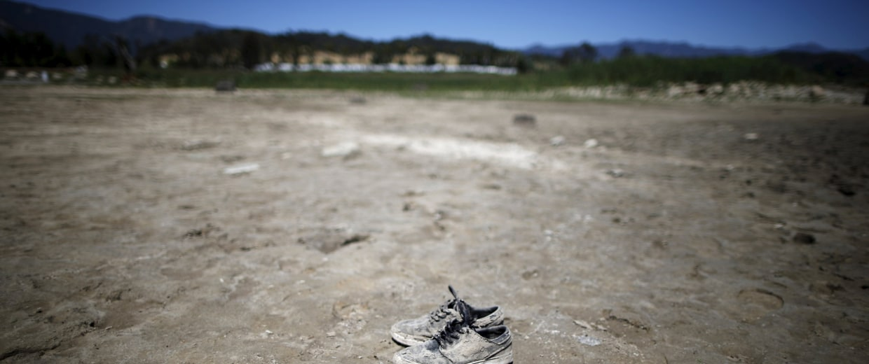 Image: A pair of shoes sits on the dry bed of a part of Lake Casitas that was formerly under water in Ojai
