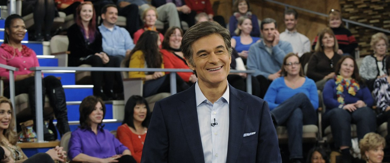 Image: Image: Dr. Mehmet Oz stands in front of the audience of The Dr. Oz Show.