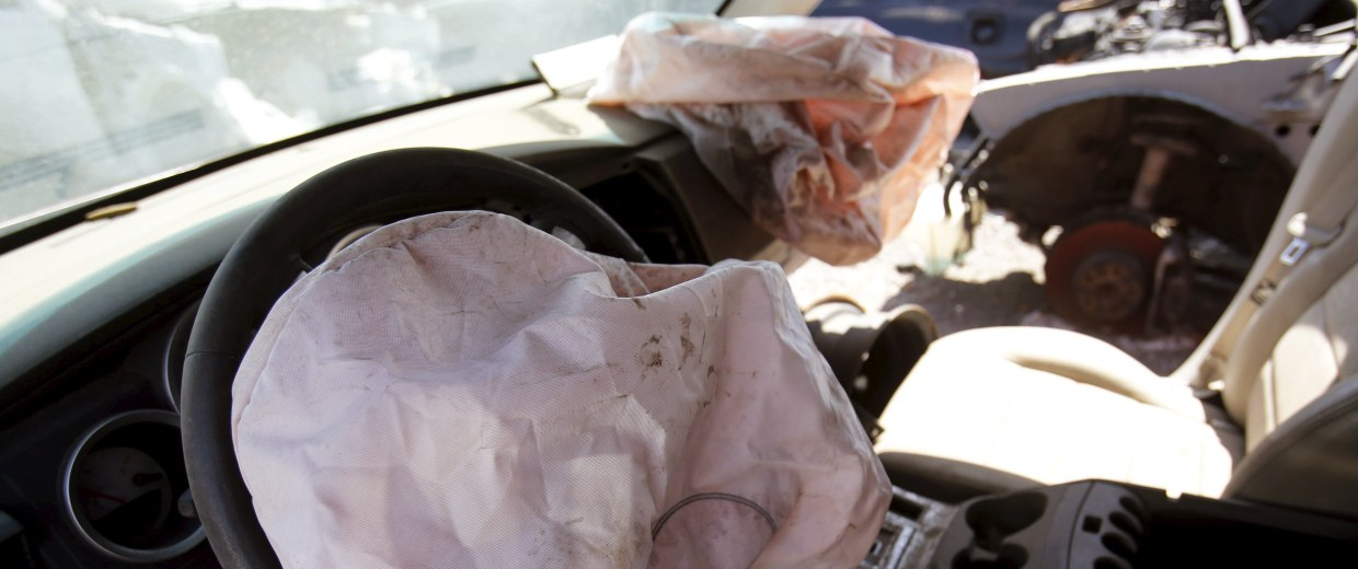Image: Deployed Takata manufactured airbags are seen on the driver and passenger side of a 2007 Dodge Charger at a recycled auto parts lot in Detroit, Michigan
