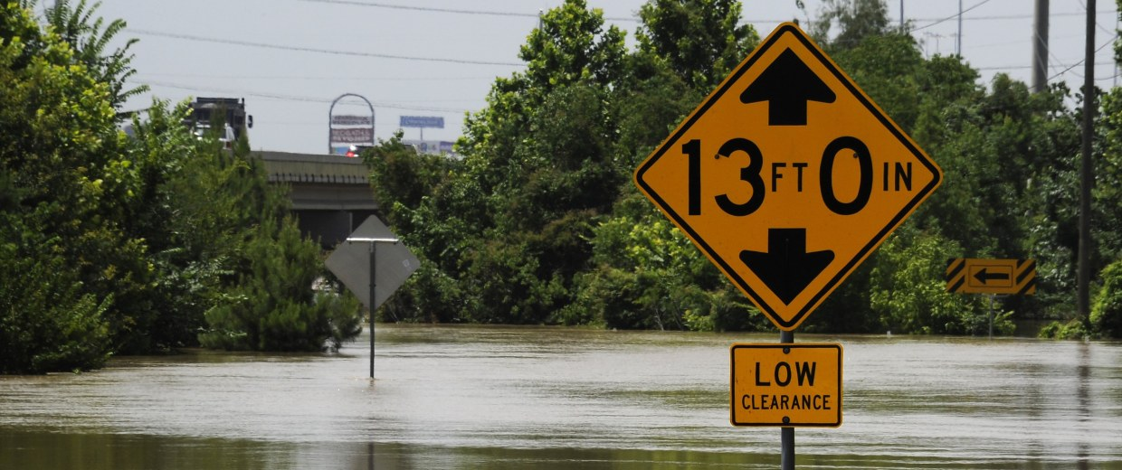 Flood water from the San Jacinto River covers a road beside the highway Thursday, May 28, 2015, in Kingwood, Texas.