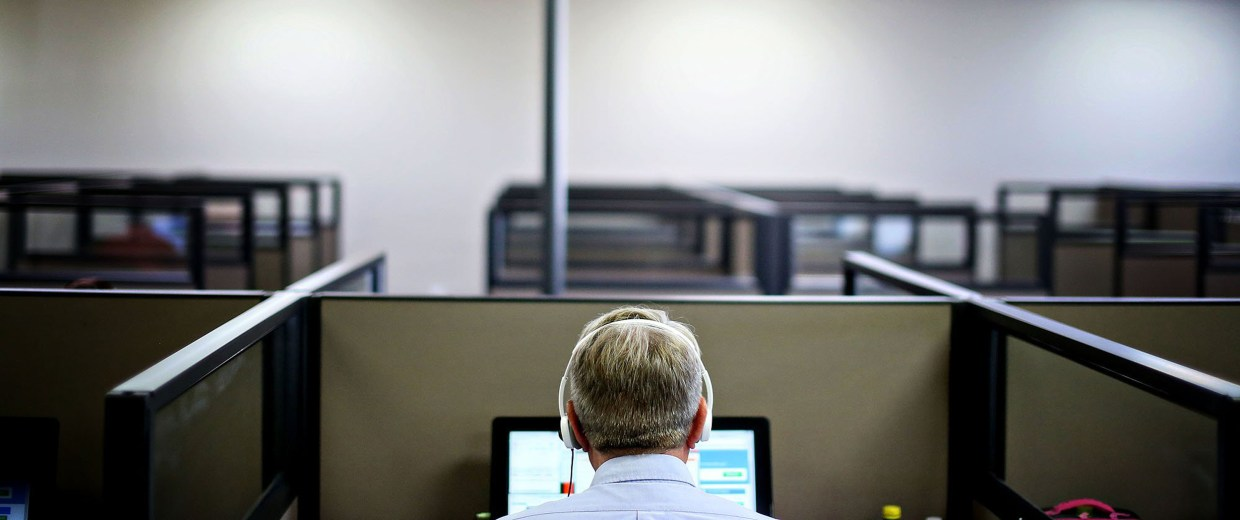 Image: A man works at a call center