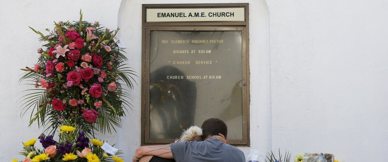 Image: Mourners Ashley Edge and Brad Hutchinson hold one another outside the Emanuel African Methodist Episcopal Church in Charleston