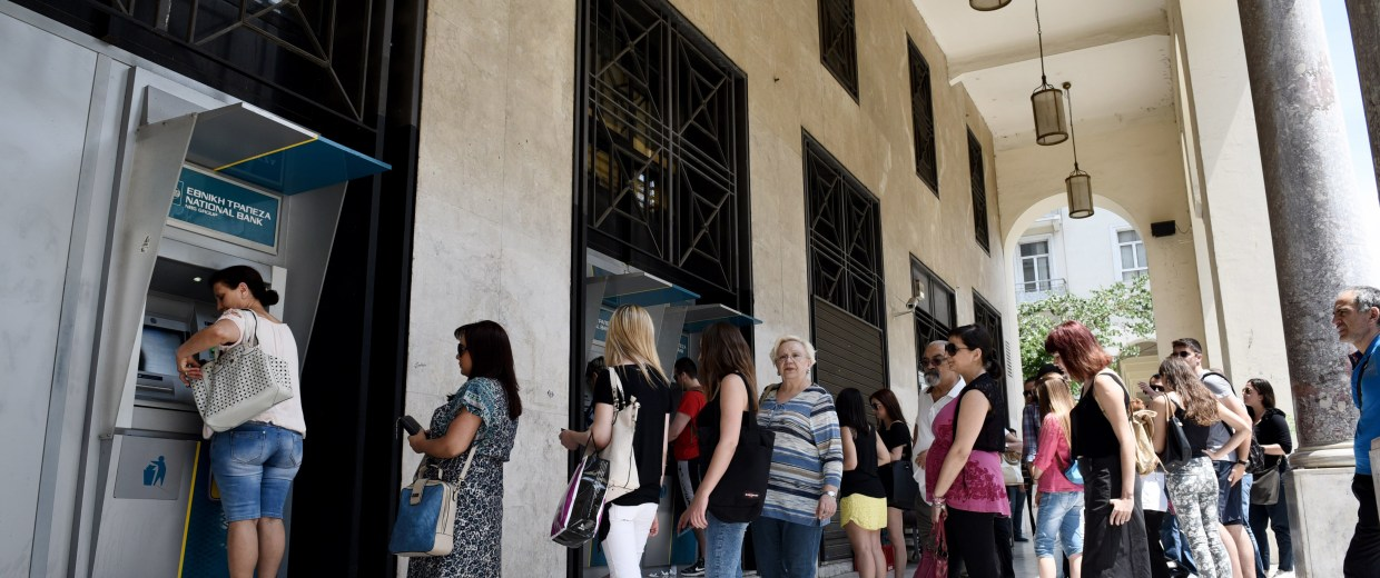 Image: Greeks line up at ATMs on Saturday.