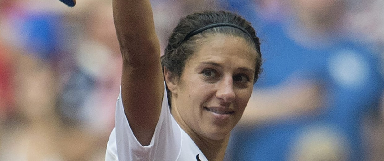 Image: United States player Carli Lloyd holds World Cup trophy
