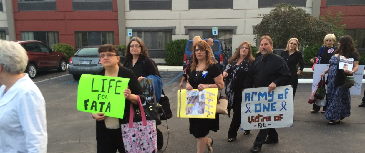 Image: Victims of Dr. Farid Fata file onto a bus to attend his sentencing