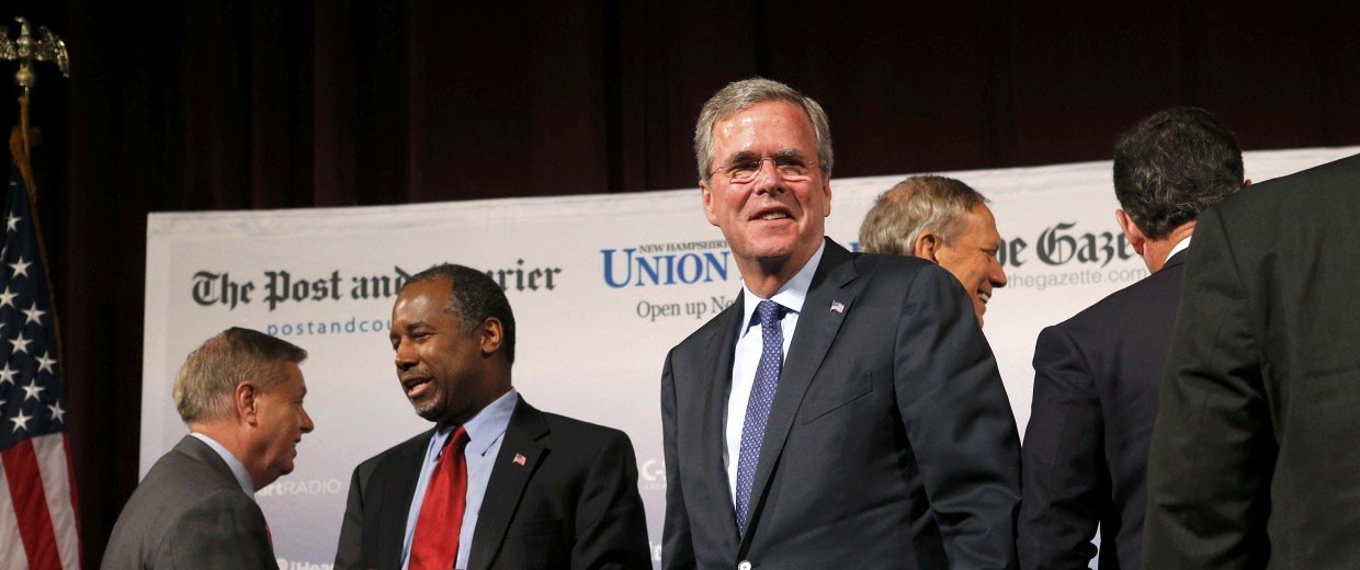 Image: U.S. Republican presidential candidate and former Florida Governor Jeb Bush walks out from among the pack of candidates after the conclusion of the Voters First Presidential Forum in Manchester