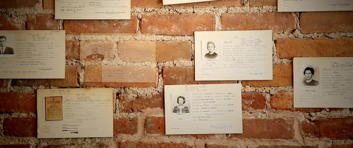Image: On the wall, cards with pictures of La Nacional's members.