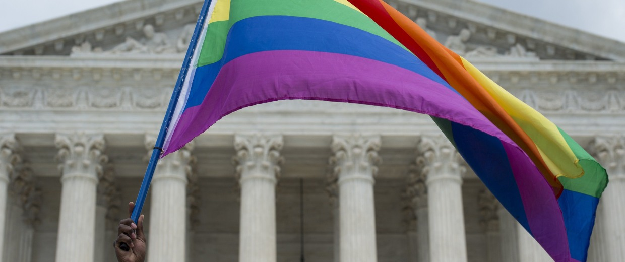 Image: A rainbow flag is flown outside the Supreme Court in Washington, DC