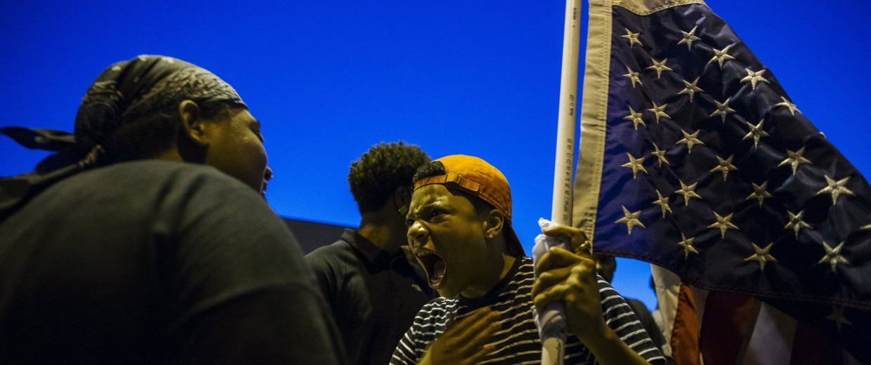 Image: Anti-police demonstrators scream as they march in protest in Ferguson, Missouri