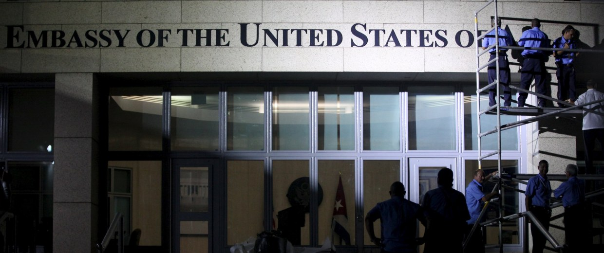 "Image: Workers place the name ""Embassy of the United States of America"" above the main entrance of the U.S. embassy in Havana"