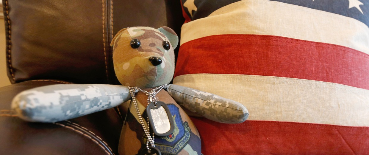 Image: a stuffed animal wearing the dog tags of the late Army Major Chad Wriglesworth