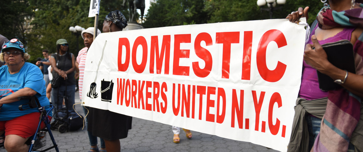 Domestic Workers United with a banner at Union Square rally