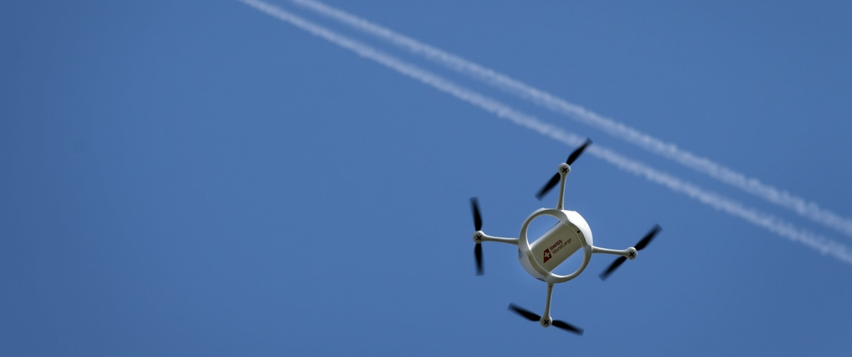 Image: This file photo shows a drone flies past the airport of Bellechasse, Switzerland.