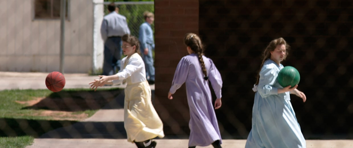 Image: Girls play separately from the boys at a private school