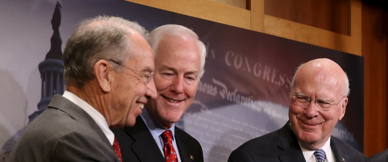 Image: Senators Grassley, Cornyn and Leahy shake hands at news conference on criminal justice reform in Washington