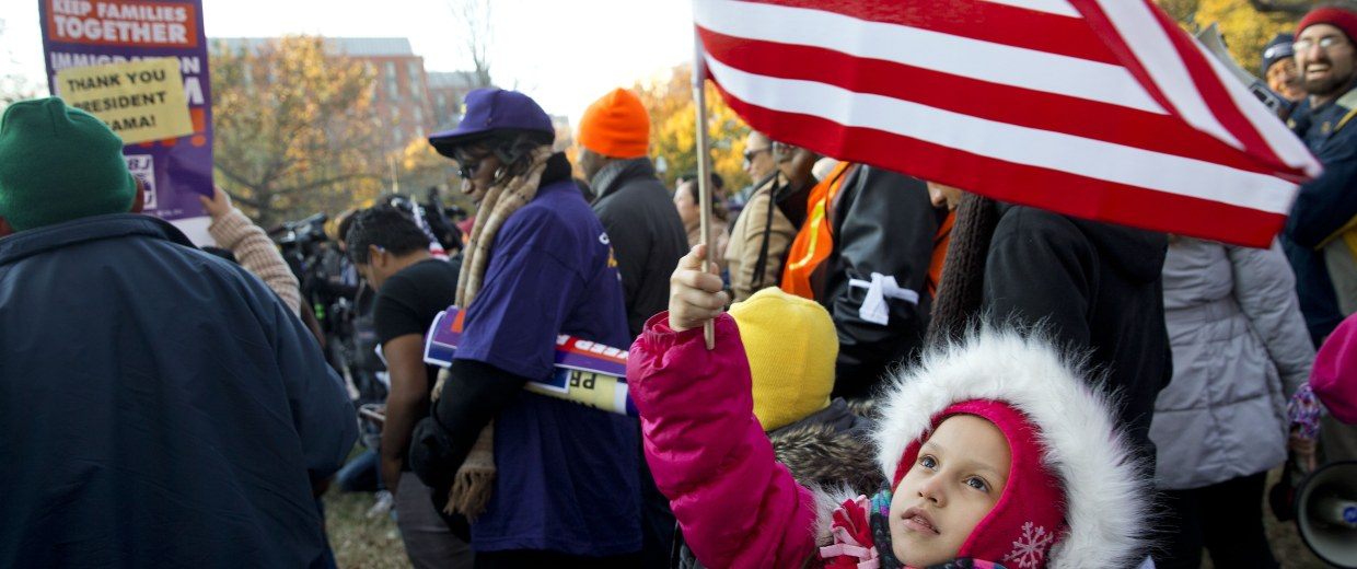 Image: Joselyn Vargas, 7, of Hyattsville, Md., waves a U.S. flag during a rally across from the White House
