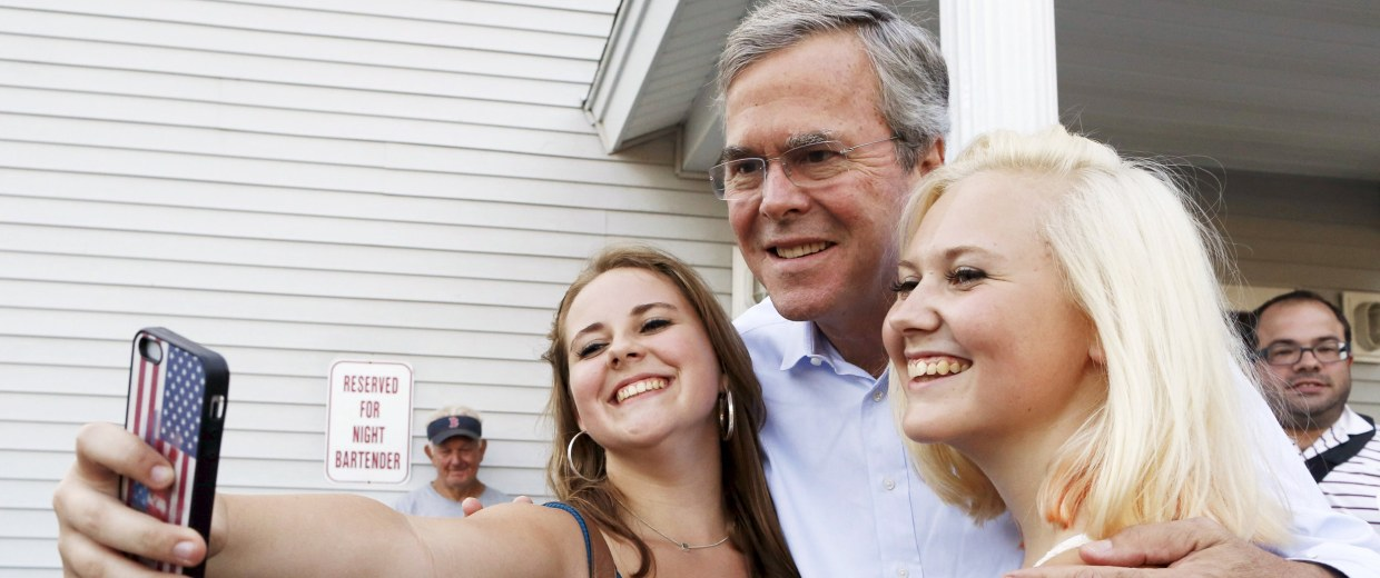 Image: Former Florida Governor and Republican candidate for president Jeb Bush poses for a selfie before a VFW town hall event in Merrimack