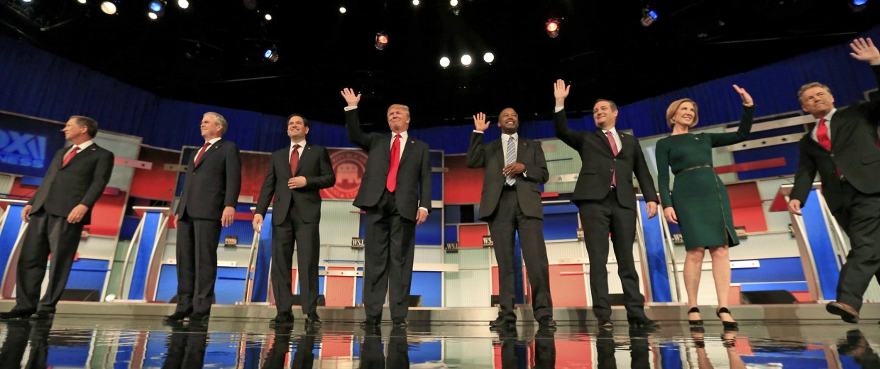 Image: Republican U.S. presidential candidates pose during a photo opportunity before the debate held by Fox Business Network for the top 2016 U.S. Republican presidential candidates in Milwaukee