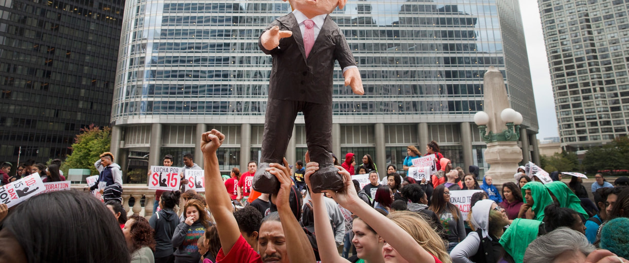 Image: Activists Protest For Immigration Reform And Fair Wages At Trump Tower In Chicago