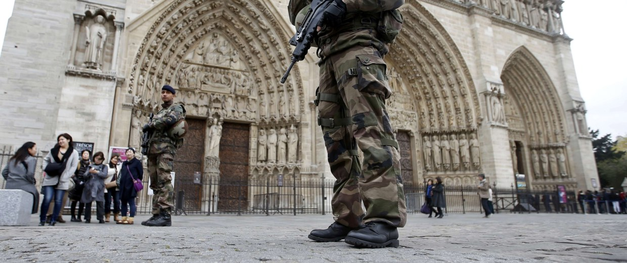 Image: Soldiers patrol in front of the Notre Dame Cathedral in Paris after last Friday's series of deadly attacks in the French capital